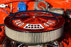 440 four barrel engine. Car red Royalty Free Stock Photo