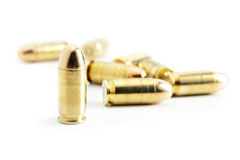 45 Caliber Bullets on White. Critical focus on bullet standing upright Royalty Free Stock Images