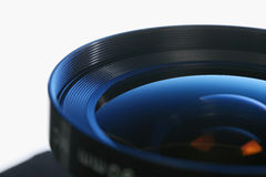 45 camera lens. 105mm 45 camera lens with blue back-light Stock Images
