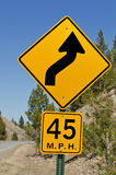 45 MPH Curve Sign. Sign to warn of 45 mph curve ahead stock images