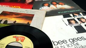 Free 45 Rpm Covers Of The BEE GEES Group. Composed Of The Brothers Barry, Robin And Maurice Gibb, The Most Successful Artists In The Hi Stock Image - 190477791