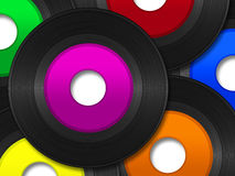 45 RPM Records. A pile of 45 RPM vinyl records with multi colored labels Royalty Free Stock Photo