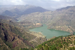 46 km long manmade Tehri lake. 46 kms long tehri lake filling up after the construction of the New Tehri  hydro electric project Dam on the river ganga in tehri Stock Image