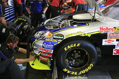 48's splitter gets adjusted. The Lowes 48 team works on the car at the 2007 NASCAR Race for the Chase at New Hampshire International Speedway Stock Image