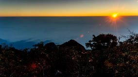 4K Timelapse, Sunrise through flowing cloud waves on hill. stock video