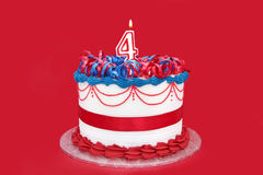 4th Cake. Fancy cake with a numeral four candle.  Vibrant red background Royalty Free Stock Photography