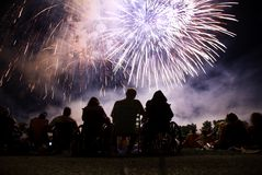 4th Of July. Watching a fourth of July fireworks display Stock Image