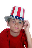 4th of July Boy. Young boy with stars and stripes hat isolated on white Royalty Free Stock Photos