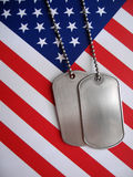 4th July Dog Tags. Dog tags and the flag of America. Focused on the dog tags royalty free stock photography