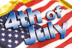 4th of July Sign. 4th of July type on an american flag background Stock Photography