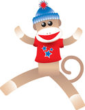 4th of July Sock Monkey. Cute illustration of a happy sock monkey wearing a red, white and blue t-shirt Stock Photos
