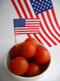 4th July Tomatoes. Eat healthy food. Snack on juicy red cherry tomatoes on 4th July royalty free stock photo