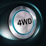 4WD Button, Four Weel Drive, 4x4 Switch. Close up of a metallic 4WD button, blue light, blur effect, automotive 4x4 switch concept. Black background Royalty Free Stock Images