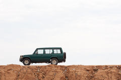 4WD car. Muddy 4WD car against white sky Stock Images