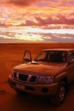 4WD CAR. On Australian desert + sunset background Stock Photography