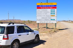 4WD car and road sign. 4WD off-road vehicle and road signs on the journey to the Australian outback, South Australia Stock Photo