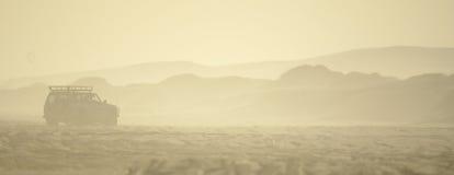 4WD CAR IN SANDSTORM. ON DESERT IN AUSTRALIA Stock Images
