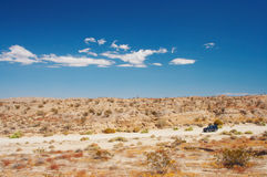 4WD in the desert. Faraway view of the car Stock Photo