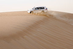 4wd desert safari. Is a popular program for tourists in dubai. it gives you an opportunity to see the Golden sand Dunes of Arabia in 4 wheel drives where you stock photo
