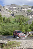 4WD Rocky Mountains Colorado. 4WD Four wheel driving across a mountain stream in the Rocky Mountains on a jeep trail between Silverton and Telluride, Colorado Stock Photography