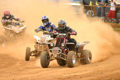 4wheel dirt riders in Puerto Rico. Multiple riders battling for firts position in national event in Puerto Rico Stock Image