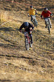 On 4x race. Mountain bikers on 4x race Royalty Free Stock Photo