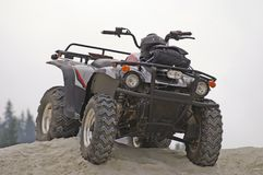 4x4. All terrain vehicle on a pile of sand Royalty Free Stock Image