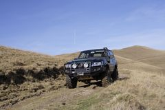 4x4 in action. An offorad vehicle in the mountains Royalty Free Stock Photos