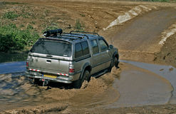 4x4 car crossing a puddle Stock Photography