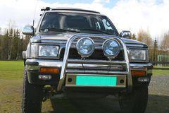 4x4 front. Sports utility vehicle with offroad spot lamps and grill guard Stock Photography