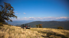 4x4 high in the mountains. Panoramic view of a 4x4 at high altitude in the Carpathian Mountains, Romania Royalty Free Stock Photos