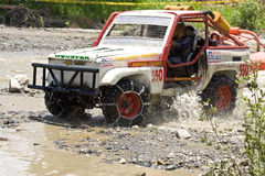 4X4 Racers through mud in Ecuador. MALACATOES LOJA ECUADOR FEB 10 2013. Custom 4X4 race on riverside Malacatoes Southern Ecuador Feb 10 2013. Town names are stock photography