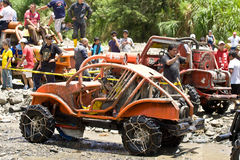 4X4 Racers through mud in Ecuador. MALACATOES LOJA ECUADOR FEB 10 2013. Custom 4X4 race on riverside Malacatoes Southern Ecuador Feb 10 2013. Town names are stock photo