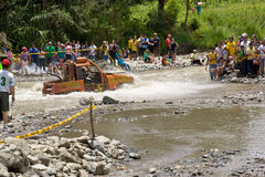 4X4 Racers through mud in Ecuador. MALACATOES LOJA ECUADOR FEB 10 2013. Custom 4X4 race on riverside Malacatoes Southern Ecuador Feb 10 2013. Town names are stock image