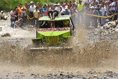 4X4 Racers through mud in Ecuador. MALACATOES LOJA ECUADOR FEB 10 2013. Custom 4X4 race on riverside Malacatoes Southern Ecuador Feb 10 2013. Town names are Royalty Free Stock Photography