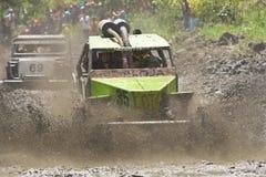 4X4 Racers through mud in Ecuador. MALACATOES LOJA ECUADOR FEB 10 2013. Custom 4X4 race on riverside Malacatoes Southern Ecuador Feb 10 2013. Town names are Royalty Free Stock Images