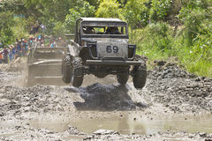 4X4 Racers through mud in Ecuador. MALACATOES LOJA ECUADOR FEB 10 2013. Custom 4X4 race on riverside Malacatoes Southern Ecuador Feb 10 2013. Town names are stock photos