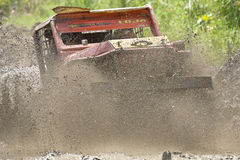 4X4 Racers through mud in Ecuador. MALACATOES LOJA ECUADOR FEB 10 2013. Custom 4X4 race on riverside Malacatoes Southern Ecuador Feb 10 2013. Town names are royalty free stock images