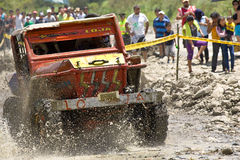 4X4 Racers through mud in Ecuador. MALACATOES LOJA ECUADOR FEB 10 2013. Custom 4X4 race on riverside Malacatoes Southern Ecuador Feb 10 2013. Town names are royalty free stock photos