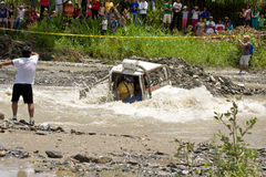 4X4 Racers through mud in Ecuador. MALACATOES LOJA ECUADOR FEB 10 2013. Custom 4X4 race on riverside Malacatoes Southern Ecuador Feb 10 2013. Town names are royalty free stock image