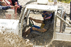 4X4 Racers through mud in Ecuador. MALACATOES LOJA ECUADOR FEB 10 2013. Custom 4X4 race on riverside Malacatoes Southern Ecuador Feb 10 2013. Town names are royalty free stock photography