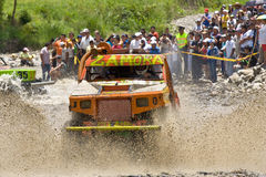 4X4 Racers through mud in Ecuador. MALACATOES LOJA ECUADOR FEB 10 2013. Custom 4X4 race on riverside Malacatoes Southern Ecuador Feb 10 2013. Town names are royalty free stock photo