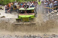 4X4 Racers through mud in Ecuador. MALACATOES LOJA ECUADOR FEB 10 2013. Custom 4X4 race on riverside Malacatoes Southern Ecuador Feb 10 2013. Town names are stock images