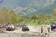 4X4 Racers through mud in Ecuador. MALACATOES LOJA ECUADOR FEB 10 2013. Custom 4X4 race on riverside Malacatoes Southern Ecuador Feb 10 2013. Town names are Stock Photo