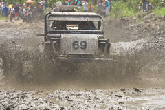 4X4 Racers through mud in Ecuador. MALACATOES LOJA ECUADOR FEB 10 2013. Custom 4X4 race on riverside Malacatoes Southern Ecuador Feb 10 2013. Town names are Stock Photography