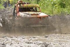 4X4 Racers through mud in Ecuador. MALACATOES LOJA ECUADOR FEB 10 2013. Custom 4X4 race on riverside Malacatoes Southern Ecuador Feb 10 2013. Town names are Royalty Free Stock Image