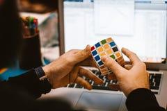 4x4 Rubik's Cube on a Man's Hand Royalty Free Stock Photos