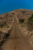 4x4 Track Hilltop. Steep 4x4 dirt road track to the top of steep hill Stock Photos