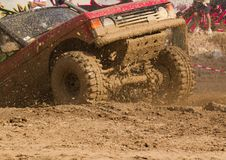 4x4 vehicle. Out of a muddy hole Royalty Free Stock Photography