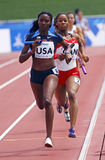 4x400 metres relay women usa canada. MONCTON, CANADA - JULY 24: Briana Nelson of USA leads Chanice Chase of Canada in the final leg of a women's 4x400 metres Stock Images